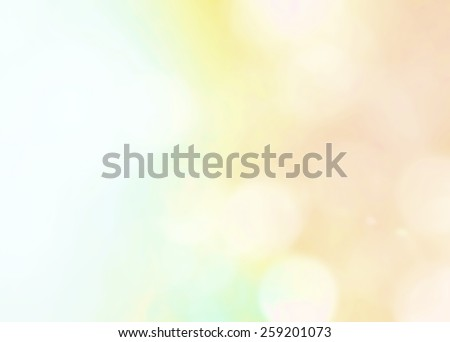Blurred natural abstract background with rainbow and bokeh  - stock photo