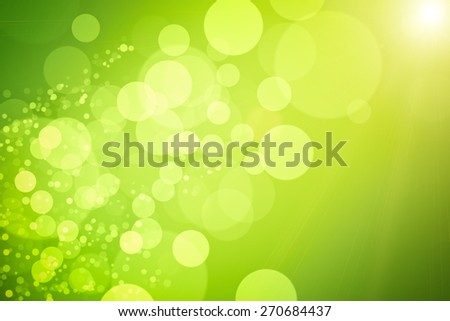 Blurred nature background. In foreground the green grass. - stock photo