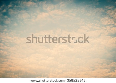 Blurred nature background of scattered clouds on sky in cool vintage color tone: Blurry natural greenery view cloudy retro style: Blissful holiday summer sandy beach dreamy vacation backdrop design - stock photo