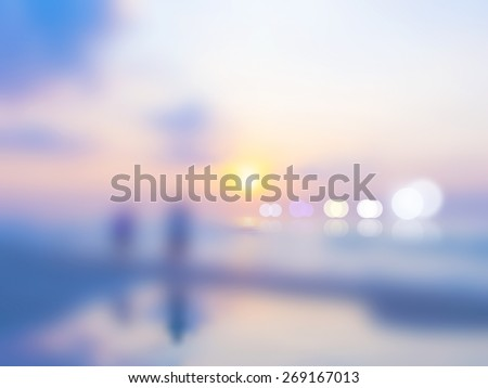 Blurred nature background, Sandy beach backdrop on bright sun set over horizontal sky - stock photo