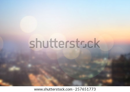 Blurred night city background with circle light.blur downtown construction structure backgrounds concept.blurry urban place sunset/sunrise hours wallpaper with glitter/sparkle round lights conception. - stock photo