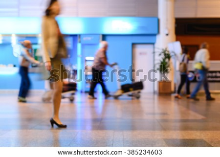 Blurred of business woman walking in airport lounge.  - stock photo