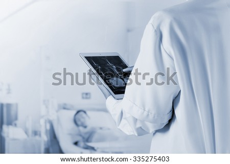 Blurred of Doctor working radiography on a digital tablet with patient on bed background - stock photo