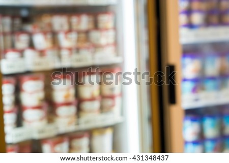 Blurred of ice cream in the refrigerator at supermarket. - stock photo