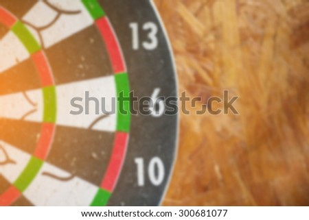 blurred of old dart target, vintage color tone ,abstract background to solution concept. - stock photo