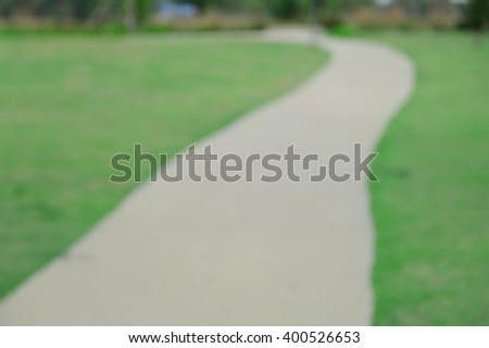blurred of stone pathway in public park. - stock photo