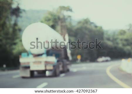 Blurred of truck on road - stock photo