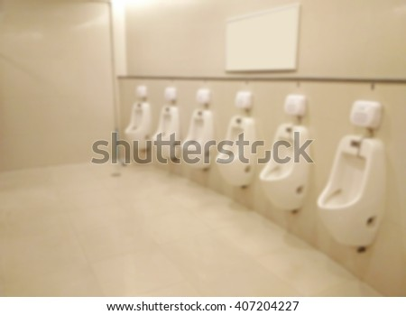 Blurred of urinals in public toilet - stock photo