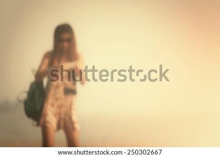 Blurred of woman using smart phone - stock photo