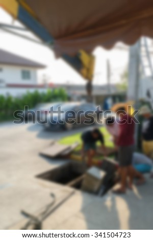 Blurred of worker working for drain cleaning. Problem with the drainage system. - stock photo