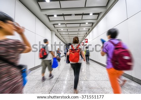 blurred passenger walking in airport - stock photo