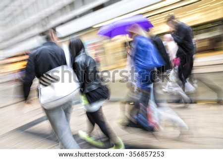 Blurred pedestrian in the city, zoom effect, motion blur - stock photo