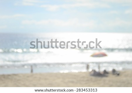 Blurred people relax on beach abstract background. - stock photo