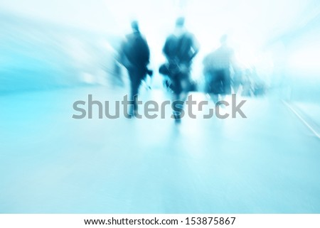 Blurred people walking in subway station. - stock photo