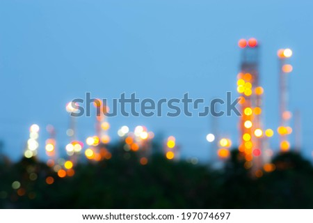 Blurred Photo bokeh for petrochemical and Oil plant at night sky - stock photo