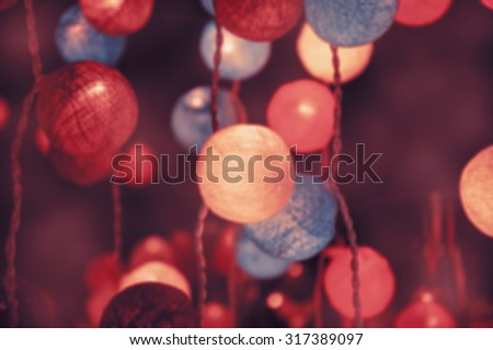 Blurred photo of colorful light cotton balls. Abstract New Year background. - stock photo