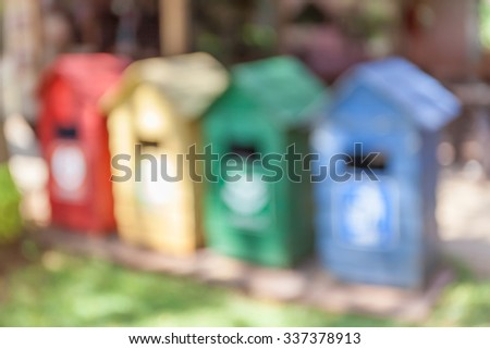 Blurred photo of different color bins for collection the recycle materials. - stock photo