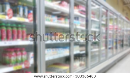 blurred picture of refrigerator in shopping center - stock photo