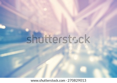 Blurred purple and blue futuristic building background at night - stock photo