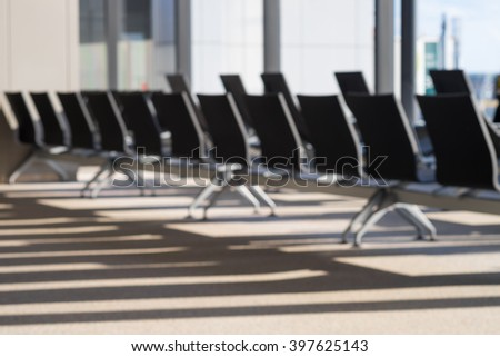 Blurred resting leather chairs with space in waiting lounge area - stock photo