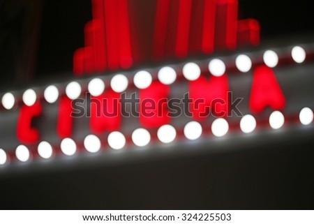 Blurred retro cinema sign with light bulbs - stock photo