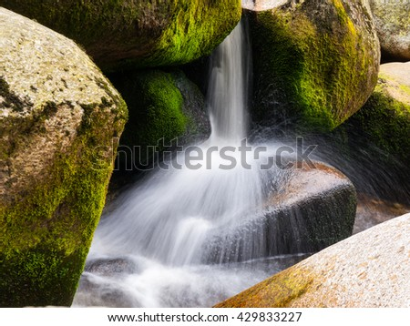 Blurred river stream detail - stock photo