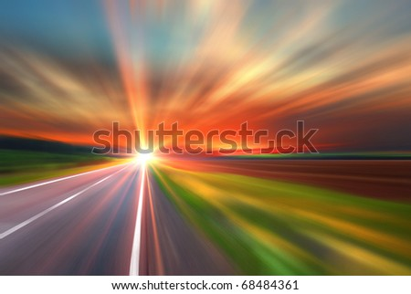 Blurred road and blurred sky with sunset - stock photo