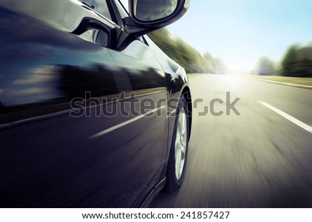 Blurred road and car, speed motion - stock photo