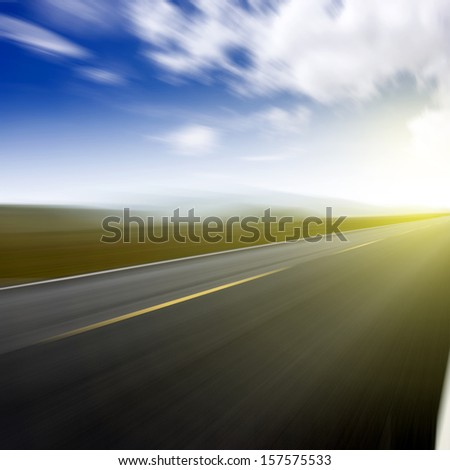 Blurred road and sky light - stock photo