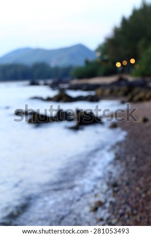 Blurred scene of evening beach. - stock photo