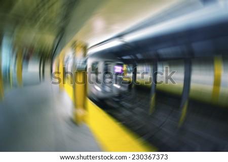 Blurred scene of fast moving train in Manhattan subway - New York transportation concept. - stock photo