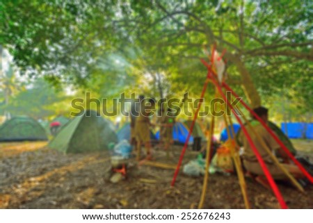 blurred scouts camping background. - stock photo