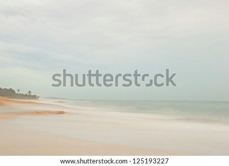 Blurred seascape, long exposure taken on a tropical beach during monsoon time. - stock photo