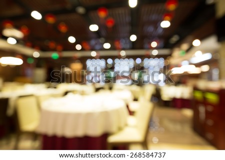 Blurred shopping mall background with color tone tuned - stock photo