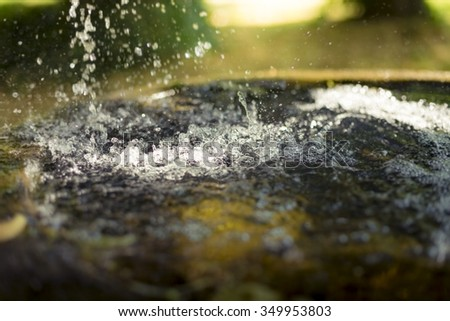 blurred shot of  water splash in a fountain - stock photo