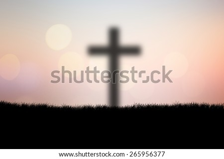 blurred silhouette cross shine on blurred twilight sky backgrounds  - stock photo