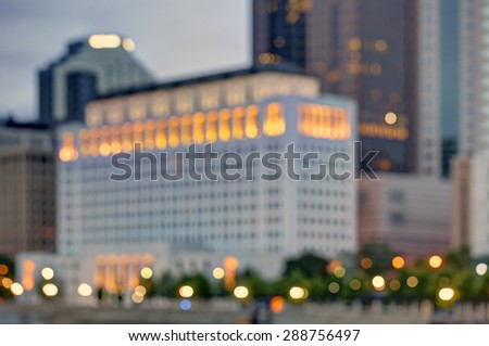 Blurred skyline at dusk with vibrant colors and interesting shapes - stock photo