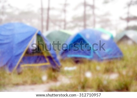 Blurred soft camping tents in raining day - stock photo