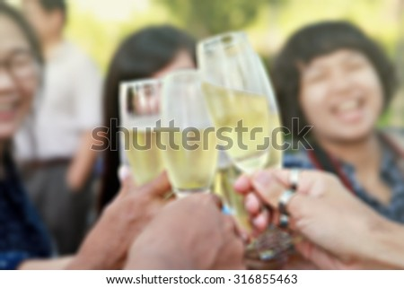 Blurred soft people are give a toast  champagne glass  for background - stock photo