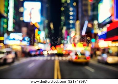 Blurred street illumination and night lights of New York City - stock photo