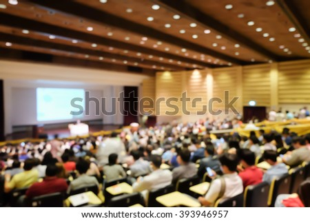 blurred student sitting for seminar or meeting about business program backgrounds:blur collaboration business discussion and listening in convention hall:blur inside meeting hall backdrop concept. - stock photo