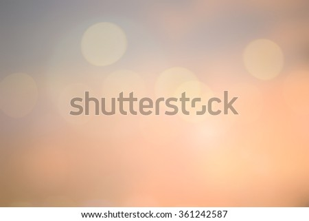 Blurred sweet colored bright background of sea nature firmament with circle bulbs lens lights.abstract golden hour dusk backdrop:sunshine glint illuminated sun rays.motion colored gradient display - stock photo