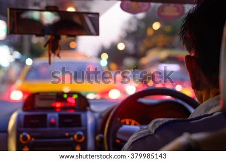 Blurred traffic jam on rush hour time, shooted from inside of car. - stock photo