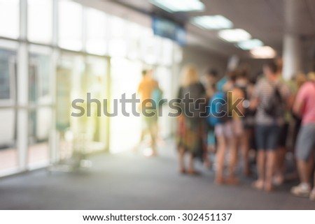 blurred Traveler at Gate in airport. - stock photo