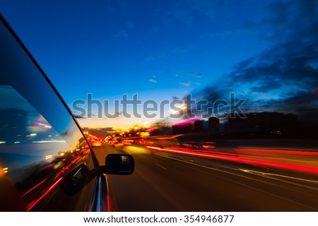blurred urban look of the car movement at nights long exposure - stock photo