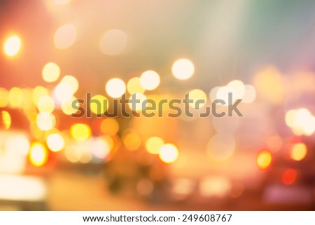 Blurred urban traffic background scene in the night - stock photo