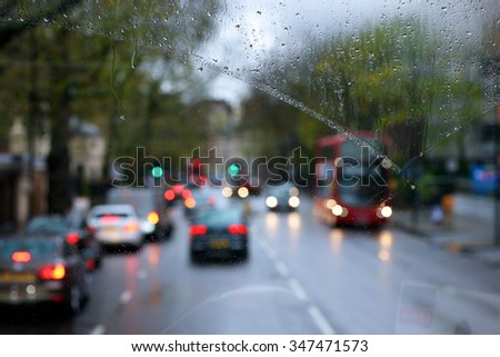 Blurred view of road traffic in London on a rainy day through the bus window - stock photo