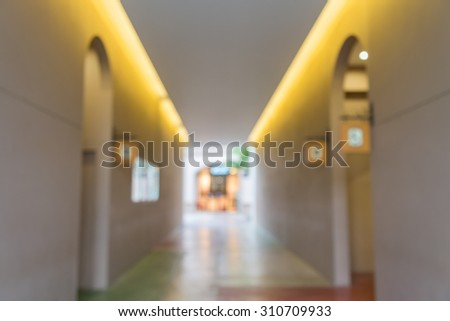 Blurred walkway to toilet in outlet mall background - stock photo