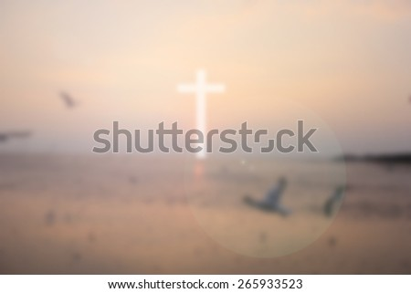 blurred white cross with sun light on blurred sky backgrounds - stock photo