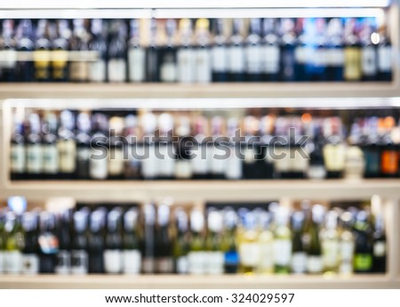 Blurred Wine Liquor bottles on shelf Wholesale shop Bar background - stock photo